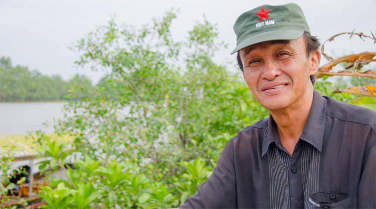Bootkapitein in de Mekong Delta in Vietnam